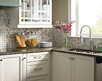 This custom kitchen features a handmade Basketweave mosaic backsplash shown in Calacatta Tia Baroque and tumbled Montevideo from New Ravenna.<br />