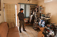 Fernando G. Rvas, artist and movie critic, at his house, Mexicali, Mexico...© Stefan Falke.http://www.stefanfalke.com/..