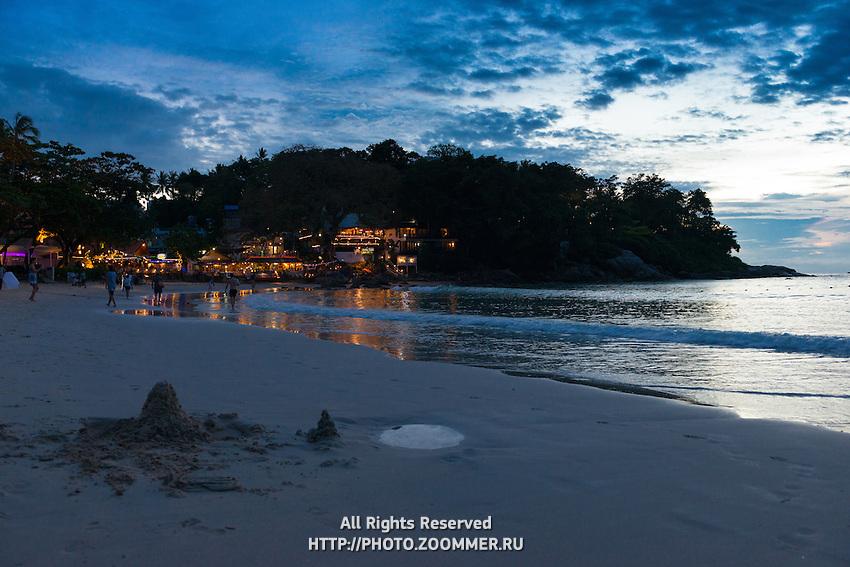 Sunset scene at Kata beach with sand pie in front, Phuket, Thailand