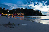 Sunset scene at Kata beach with sand pie in front, Phuket, Thailand