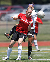 Aztec MA defender Dana Bergstrom (21) heads the ball. In a Women's Premier Soccer League (WPSL) match, Aztec MA defeated CFC Passion, 4-0, at North Reading High School Stadium on July 1, 2012.