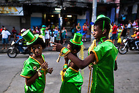 Brazilian boys, wearing green costumes, take part in the Carnival parade in the favela of Rocinha, Rio de Janeiro, Brazil, 20 February 2012. Rocinha, the largest shanty town in Brazil and one of the most developed in Latin America, has its own samba school called GRES Academicos da Rocinha. The Rocinha samba school is very loyal to its neighborhood. Throughout the year, the entire community actively participate in rehearsals, culture events and parades related to the carnival.