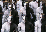 As I wandered amidst hundreds of tribesmen preparing to compete in their annual dance competitions held in the highlands on Papua New Guinea, I noticed a group of Simbu dancers applying black and white pigment to their bodies. Once they finished, I approached them without the aid of an interpreter. Using body language, I encouraged them to lineup in a manner that accentuated their graphic design. Fortunately, they obliged without hesitation.