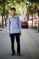 Xiaoguangheng, no occupation given, age 23, poses for a portrait in Beijing. Response to 'What does China mean to you?': 'China means the People's Republic of China'  Response to 'What is your role in China's future?': 'Beloved mother country--I will work really hard. Struggle.'