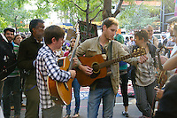Men play guitars at the Occupy Wall Street Protest in New York City October 6, 2011.