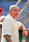 21 June 2011: Washington Nationals General Manager Mike Rizzo watches batting practice prior to a game against the Seattle Mariners at Nationals Park in Washington, District of Columbia. The Nationals rallied from a 5-1 deficit, scoring 5 runs in the bottom of the 9th, to defeat the Mariners 6-5 in inter-league play. Mandatory Credit: Ed Wolfstein Photo