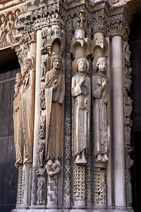 .West Facade, right Portal, left jam c. 1145,  Cathedral of Notre Dame, Chartres, France. Gothic statues of four elongated human figures. A UNESCO World Heritage Site. .