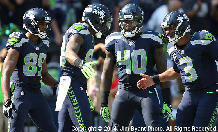 Seattle Seahawks wide receiver Ricardo Lockette (83) celebrates with teammates quarterback Russell Wilson , Doug Baldwin and Derrick Coleman after catching a 39-yard touchdown pass from against  Denver Broncos cornerback Aqib Talib (21) in the first quarter at CenturyLink Field in Seattle, Washington on September 21, 2014. The Seahawks won 26-20 in overtime.    ©2014. Jim Bryant Photo. All rights Reserved.