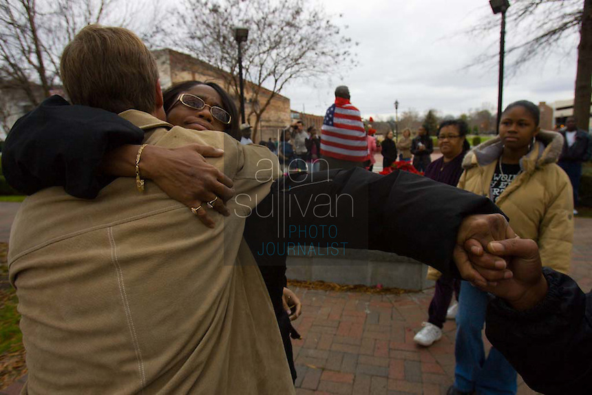 Venisha Brown, daughter of singer James Brown and one-time backup singer Yvonne Fair, with Augusta, Ga. mayor Deke Copenhaver by a statue of the hometown singer on Broad Street. James Brown died in Atlanta on Monday, Dec. 25. Also pictured are James Brown's great-granddaughter Chelsea Dean (from right) and daughter-in-law Diane D. Rowes.<br />