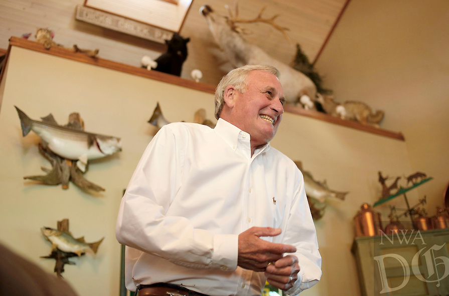 NWA Democrat-Gazette/DAVID GOTTSCHALK  Kirk Dupps tells one of his many fishing stories Friday, May 13, 2016, in the living room of his home that overlooks Beaver Lake in Eureka Springs. Dupps and his wife Cynthia are the 2016 Color of Hope Chairmen in Northwest Arkansas. Dupps spent 20 years working for Kroger, transitioned to the Phillips Company and became Sr. Vice President of Sales &amp; Marketing of Walton Enterprises grocery operations. He later became head of Sam's Club in the 1990s. He was instrumental in the success of the Phillips Pro-Classic Golf tournament that raised millions for Arkansas charities, including Arkansas Children's Hospital.<br /> Dupps became Commissioner of the Arkansas Game &amp; Fish Commission in 1996. Since 1998, he has  been a senior partner, retail consultant and speaker for Diversified Retail Solutions. In 2005, he cofounded White River Bank and Signature Bank.