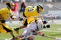 Michigan's Chase Brown (49) gets called for a foul as he lands on top of Ohio State's Jesse King (19) in the fourth quarter of the NCAA lacrosse game between the Ohio State Buckeyes and Michigan Wolverines at Ohio Stadium in Columbus, Saturday morning, April 12, 2014. The Ohio State Buckeyes defeated the Michigan Wolverines 15 - 6. (The Columbus Dispatch / Eamon Queeney)