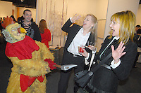 West of Romes' Crazy Chicken pretends to attack Hollywood's celebrity gossip columnist Janet Charlton (right) and Jean Dickinson during the opening reception of Art Los Angeles Contemporary at the historic Barker Hangar on Thursday, January 27, 2011.
