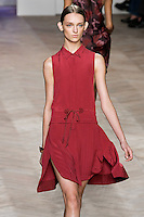 Daga Ziober walks the runway in a raspberry silk placket front sleeveless shirtdress with shirttail hem and pleated skirt, by Tommy Hilfiger for the Tommy Hilfiger Spring 2012 Pop Prep Collection, during Mercedes-Benz Fashion Week Spring 2012.