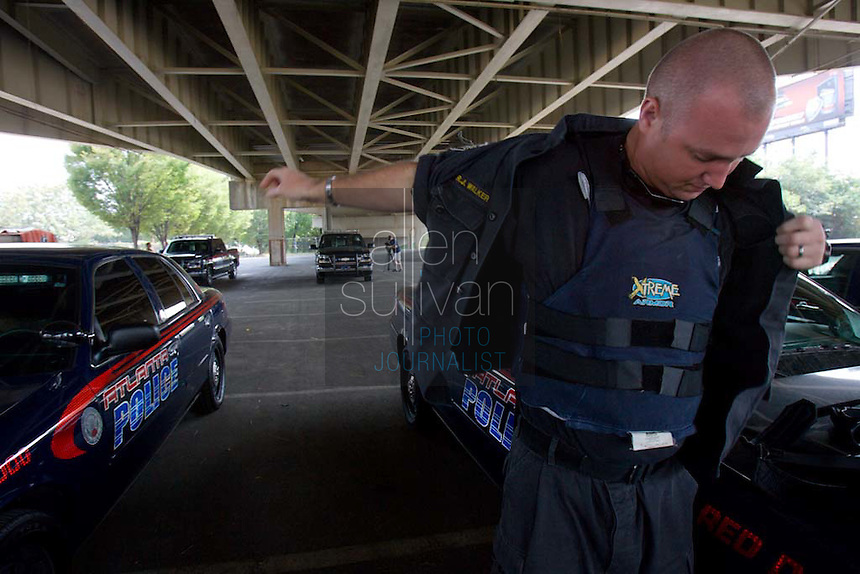Atlanta Police Department Sergeant R.J. Walker prepares for sweeps in the Vine City Terrace Apartments and Bowen Homes on Saturday, August 18, 2007. Police said they found drugs, drug money and at least one stolen car during the sweeps.