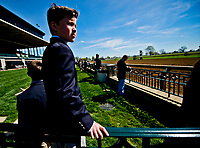 LEXINGTON, KENTUCKY - APRIL 07: A young boy watches horses on the track before an undercard race on opening day at Keeneland Race Course on April 7, 2017 in Lexington, Kentucky. (Photo by Scott Serio/Eclipse Sportswire/Getty Images)