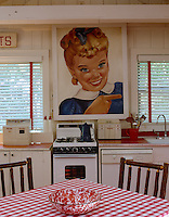 A bright cartoon-style 1950s poster of the Sunbeam bread girl complements the vintage-style decor and theme of this kitchen