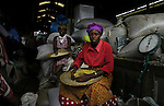 Grain sellers take a break in owino Market in Kampala, Uganda. The massive open-air market is a source of good for many of Kampala's citizens and offeres everything from grain and fresh beef to machine parts, and used clothes. (Rick D'Elia)<br />