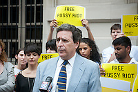 Members of Amnesty International, joined by activist lawyer Norman Siegel, center, stand near the Russian Consulate in New York on Friday, July 27, 2012 calling for the release from excessive detention of three members of the female Russian punk band Pussy Riot. Nadezhda Tolokonnikova, Maria Alekhina and Yekaterina Samutsevich.  members of the band have been held in pre-trial detention since March of this year after protesting against Russian President Putin via an unauthorized performance in the Christ the Saviour Cathedral in Moscow. They face up to seven years in jail on hooliganism charges. . (© Richard B. Levine)