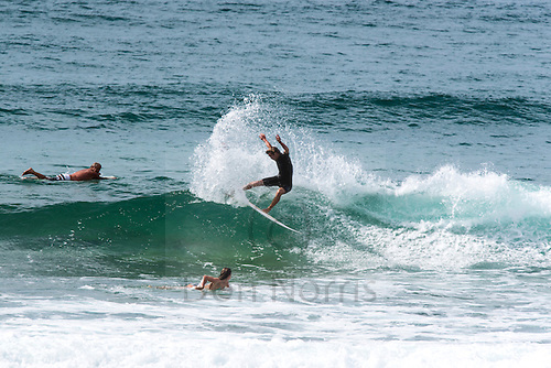 Just about flat everywhere, but the crew were finding moments of fun on a warm April day at North Narrabeen.