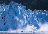 DIGITALLY MODIFIED: Tidewater face of Meares glacier calves into Prince William Sound, Alaska.