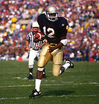 SOUTH BEND, IN-1988:  Notre Dame running back Ricky Watters is pictured running with the ball during a game against the University of Miami.  (Photo by Ron Vesely)