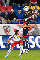 Kalifa Cisse (4) of the New England Revolution heads the ball. The New York Red Bulls defeated the New England Revolution 4-1 during a Major League Soccer (MLS) match at Red Bull Arena in Harrison, NJ, on March 20, 2013.
