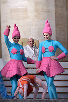 Clowns perform in front of Pope Francis during his weekly general audience in St. Peter square at the Vatican, Wednesday.January 27, 2016