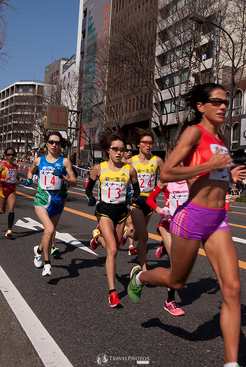 South Africa's Rene Kalmer (in red) led the field for the first half of the race. Japan's Yoshimi Ozaki (number 13) came second in the Nagoya Women's Marathon, qualifying her for the London 2012 Olympics. Yukiko Akaba (#14), Misaki Katsumata (#24), and Yoko Miyauchi (#25) also pictured.