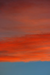 A close up, abstract view of an amazing cloud formation, in the flaming light of sunset.