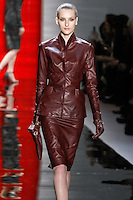 Katia walks runway in a bordeaux funnel-neck leather jacket with Bordeaux slim buttery leather pencil skirt, from the Reem Acra Fall 2012 Feminine Power collection fashion show, during Mercedes-Benz Fashion Week New York Fall 2012 at Lincoln Center.