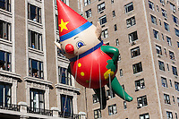 NEW YORK - NOVEMBER 24:  A holiday elf (Charlie, Kit and C.J. holiday elves) helium filled balloon floats overhead during the annual Macy's Thanksgiving Day Parade on Thursday, November 24, 2011.