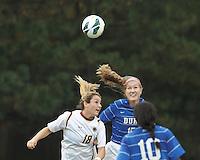Boston College midfielder Patrice Vettori (18) and Duke University midfielder Kara Wilson (15) battle for head ball. Boston College (white) defeated Duke University (blue/white), 4-1, at Newton Campus Field, on October 6, 2013.