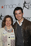 Sharon Cohen poses with Kevin Jonas at the 2012 Skating with the Stars - a benefit gala for Figure Skating in Harlem celebrating 15 years on April 2, 2012 at Central Park's Wollman Rink, New York City, New York.  (Photo by Sue Coflin/Max Photos)