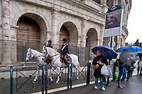 Roma 23 Novembre 2015<br /> Colosseo sorvegliato speciale in vista del Giubileo essendo un luogo di forte impatto turistico. Il piano, ideato dalla questura con la prefettura e forze dell&rsquo;ordine, prevede un potenziamento dei controlli antiterrorismo nella zona intorno al Colosseo. Carabinieri durante i controlli antiterrorismo al Colosseo. Carabinieri a cavallo durante i controlli antiterrorismo al Colosseo.<br /> Rome 23 November 2015<br /> Colosseum special surveillance in view of the Jubilee being a place of great tourist impact. The plan, devised by the police with the prefecture, provides for the reinforcement of anti-terrorism controls in the area around the Colosseum.  Carabinieri  during anti-terrorism controls the Colosseum. Carabinieri on horseback during the anti-terrorism controls the Colosseum.