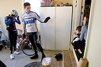 Discovery Channel Pro Cycling Team racer George Hincapie waves to his daughter Julia and wife Melanie before heading out on a training ride. Hincapie's neighbor, Craig Lewis of Team TIAA-CREF, is at left. Long successful in the European classics, in addition to being Lance Armstrong's right hand man on the team, Hincapie took his first Tour de France stage win in 2005.<br />