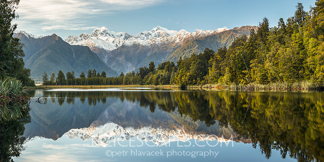 Morning over Lake Matheson with reflections of Mt. Cook and Mt. Tasman, Westland Tai Poutini National Park, West Coast, UNESCO World Heritage Area, South Westland, New Zealand, NZ