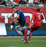 Manchester United forward Federico Macheda (27) fires off a shot in front of Chicago Fire defender Cory Gibbs (5).  Manchester United defeated the Chicago Fire 3-1 at Soldier Field in Chicago, IL on July 23, 2011.
