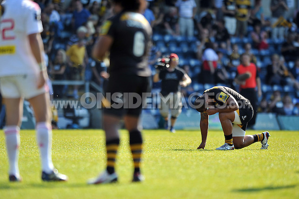 Taione Vea after the final whistle. European Champions Cup play-off, between London Wasps and Stade Francais on May 18, 2014 at Adams Park in High Wycombe, England. Photo by: Patrick Khachfe / JMP