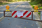 Barricades at the entrance to Rock Creek Park in Chevy Chase, Maryland on Tuesday, October 1, 2013.  The National Park Service has closed all of its facilities due to Congress not passing a funding bill by midnight September 30.  The road, Rock Creek Parkway, which runs through the park, is a major thoroughfare for motor vehicles and bicycles between the Maryland suburbs and downtown Washington, D.C.<br /> Credit: Ron Sachs / CNP<br /> (RESTRICTION: NO New York or New Jersey Newspapers or newspapers within a 75 mile radius of New York City)