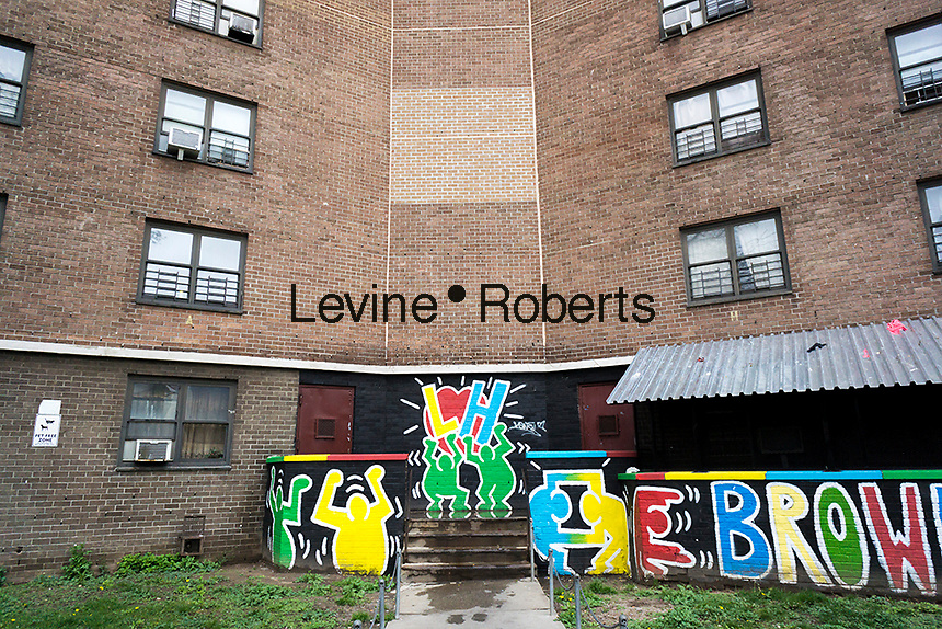 Mural in the style of Keith Haring at the Langston Hughes housing projects in the Brownsville neighborhood of Brooklyn in New York on Saturday, May 7, 2016.  (© Richard B. Levine)