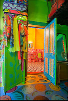 BNPS.co.uk (01202 558833)<br /> Pic: PhilYeomans/BNPS<br /> <br /> Bathroom.<br /> <br /> Britain's wackiest property has come on the market...And the estate agents mantra of paint everything magnolia has definately not been applied.<br /> <br /> It may look like an idyllic cottage in the Forest of Dean from the outside but ceramic artist Mary Rose Young's unique taste has transformed the interior into what looks like something from Alice in Wonderland.<br /> <br /> The three-bedroomed house is decorated from head to toe in crazy colours, clashing patterns, and enormous murals,<br /> each room is covered in the garish designs, including the bathroom, where even the sink and toilet have been adorned in bright tiles.<br /> <br /> Estate agents Bidmead Cook now have the tricky task of showing prospective punters round the &pound;500,000 property.