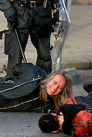 22.03.2003, Oslo Norway: .Anti war protest (Iraq war) started peacefully, but eventually escalated into riots and clashes with police. Protest-legend (in Norway) Stein Lillevolden arrested with girlfriend, apparently happy to have been so again.