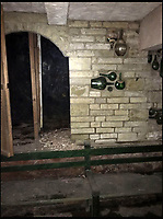 BNPS.co.uk (01202 558833)<br /> Pic: GigglingSquid/BNPS<br /> <br /> The cellar where the wine was found.<br /> <br /> Restaurateurs struck it lucky when they uncovered a hidden wine cellar containing &pound;20,000 of vintage wines under their new premises.<br /> <br /> The unexpected discovery was made in a former Italian eatery by builders working at the premises for its new owners.<br /> <br /> They uncovered a trap door and underneath it were stairs to a cellar with decorative old wine bottles welded into the walls and Second World War style lanterns.<br /> <br /> After contending with 2ft of gushing water, they found cases of unopened wine bottles, the contents of which would entice any connoisseur, including several bottles of Chateau Latour.