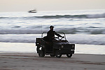 A Palestinian man rides his vehicle during sunset at the beach of Gaza sea on January 31, 2015. Photo by Mohammed Asad