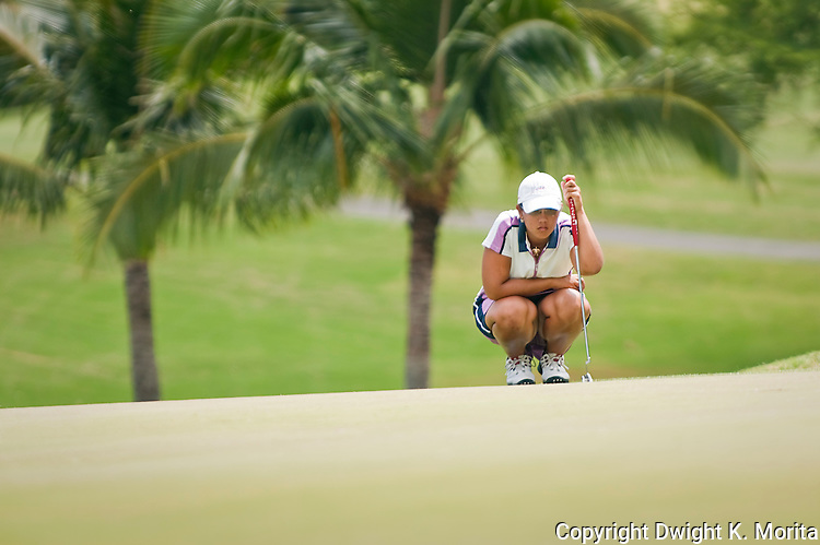 Kristina Merkle surveys the green as she prepares to putt on her way to winning the MPCC Jennie K Tournament