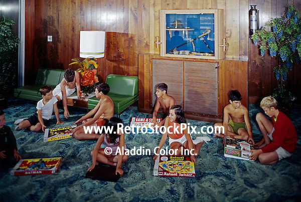 Group of children playing board games on the floor of the motel lobby.