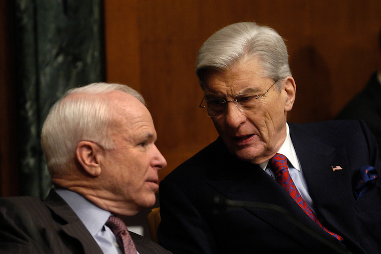 Sen. John McCain, R-Az., and Chairman John Warner, R-Va., speak at an Senate Armed Services Committee Defense Authorization hearing on the FY2007 Defense Department budget and the Future Years Defense Program..