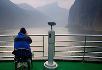 Tourist takes photographs from the deck of Victoria Line Cruise Ship, Yangze River, China