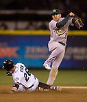 Oakland Athletics shortstop Cliff Pennington turns a double play against the Seattle Mariners  in the eight inning at SAFECO Field in Seattle April 13, 2012. The Athletics beat the Mariners 4-0.   © 2012. Jim Bryant Photo. All Rights Reserved.  .