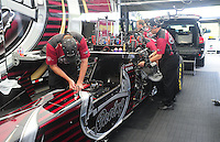 Jun. 17, 2011; Bristol, TN, USA: Crew members work on the car of NHRA top fuel driver Larry Dixon during qualifying for the Thunder Valley Nationals at Bristol Dragway. Mandatory Credit: Mark J. Rebilas-